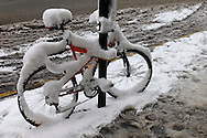 Snow covered bicycle, Barbican, London, Britain, 2 Feb 2009