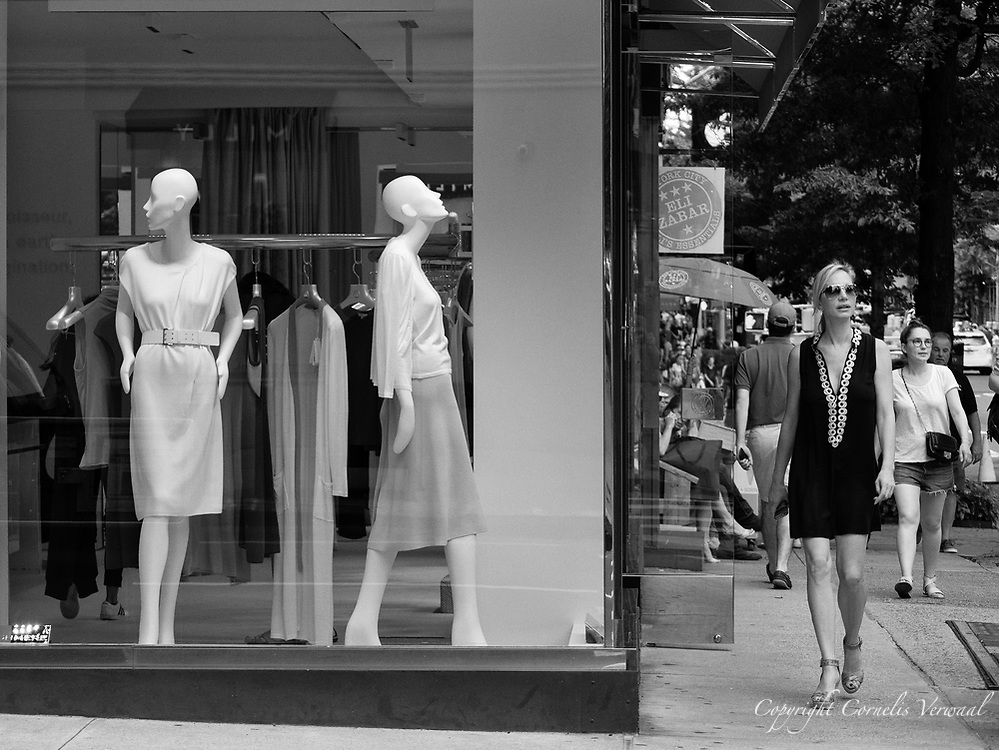 The Mannequins seem to immitate the passers-by on Madison Avenue