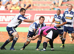 Nick Koster of the DHL Stormers takes on Janro van Niekerk of Boland during the final warm-up match before the start of the Super Rugby season between the DHL Stormers and the Boland Cavaliers held at DHL Newlands Stadium in Cape Town, South Africa on 12 February 2011. Photo by Jacques Rossouw/SPORTZPICS