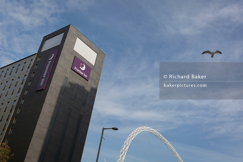 An exterior view of the Premier Inn hotel with the famous arch of Wembley Stadium, on 6th November 2019, in Wembley, London, England.