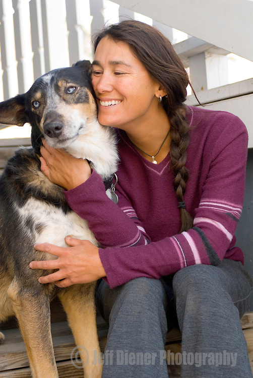 A young woman hugs her dog in Jackson, Wyoming.