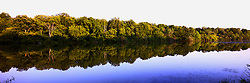 18 July 2014: a three images sitched panoraic of trees lining the banks of Dawson Lake located in Moraine View State Park maintained by the Illinois Department of Natural Resources (IDNR) near Le Roy Illinois This images has been created in part using High Dynamic Range (HDR) or Panoramic Stitching processes.