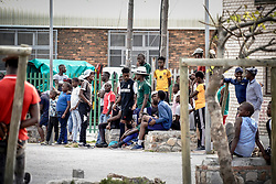 """Police Operations and Essential Services Personnel operating under lockdown period in Fish Hoek and Masipumelela in the Cape Peninsula, near Cape Town, Western Cape, South Africa, RSA <br /> <br /> Luyanda Lendile and his pavement hawker mate want me to throw them some money """"so we do not have to go and steal""""."""