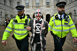 © Licensed to London News Pictures. 07/10/2019. London, UK. An Extinction Rebellion protestors being arrested by police in Westminster . Activists will converge on Westminster blockading roads in the area for at least two weeks calling on government departments to 'Tell the Truth' about what they are doing to tackle the Emergency. Photo credit: Ben Cawthra/LNP