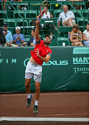 April 13, 2018 - Houston, TX, U.S. - HOUSTON, TX - APRIL 13:  Ivo Karlovic of Croatia watches his serve in the match against Nick Kyrgios of Australia during the Quarterfinal round of the Men's Clay Court Championship on April 13, 2018 at River Oaks Country Club in Houston, Texas.  (Photo by Leslie Plaza Johnson/Icon Sportswire) (Credit Image: © Leslie Plaza Johnson/Icon SMI via ZUMA Press)