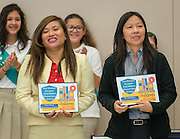 Nirmol Lim and Sandy Gaw react during a Children at Risk awards presentation to area schools at Pilgrim Academy, June 6, 2016.