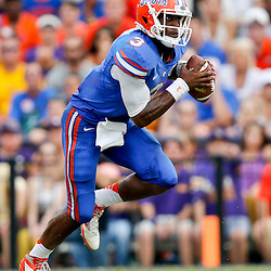 Oct 12, 2013; Baton Rouge, LA, USA; Florida Gators quarterback Tyler Murphy (3) runs with the ball against the LSU Tigers during the second half of a game at Tiger Stadium. LSU defeated Florida 17-6. Mandatory Credit: Derick E. Hingle-USA TODAY Sports