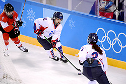 PYEONGCHANG, Feb. 10, 2018  Choi Jiyeon (C) of the unified team of the Democratic People's Republic of Korea (DPRK) and South Korea drives the puck during their preliminary match of women's ice hockey against Switerland at the Pyeongchang 2018 Winter Olympic Games at the Kwandong Hockey Centre in Gangneung, South Korea, on Feb. 10, 2018. (Credit Image: © Wang Song/Xinhua via ZUMA Wire)