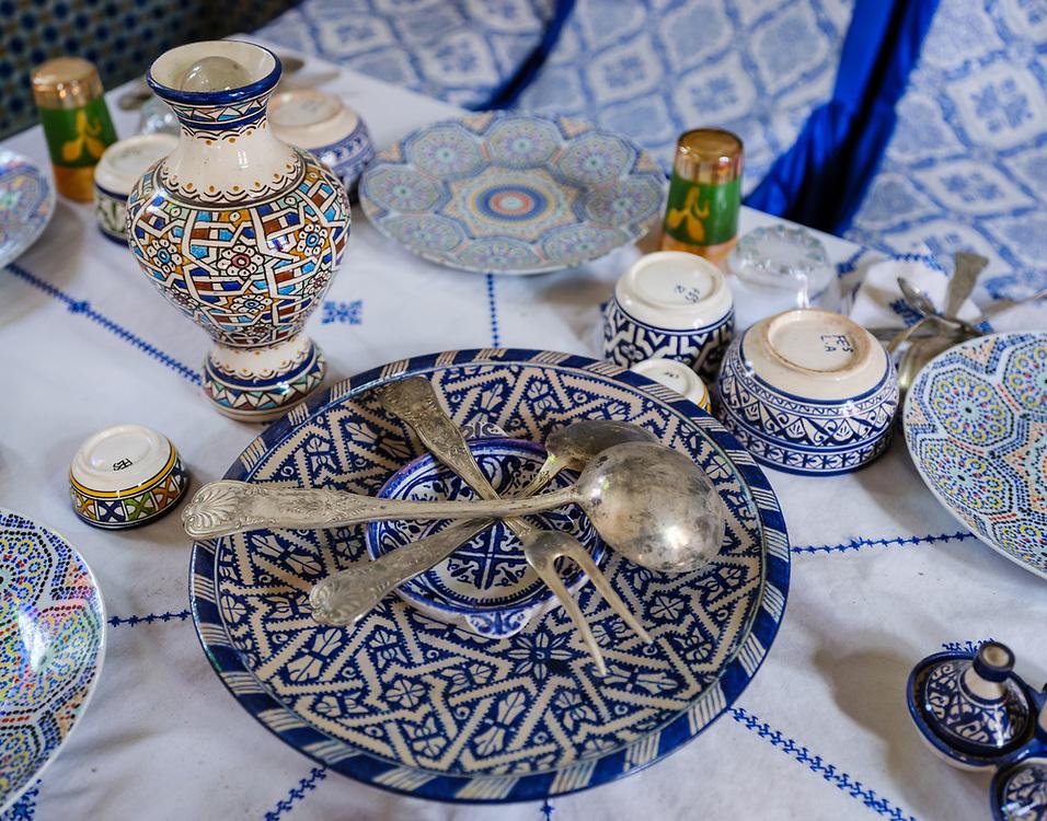 FEZ, MOROCCO - CIRCA APRIL 2017:  Old and classic Moroccan ceramic dishes and silverware.