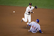 San Francisco Giants second baseman Joe Panik (12) jumps over Chicago Cubs first baseman Anthony Rizzo (44) for a double play during the third inning of Game 4 of the NLDS at AT&T Park in San Francisco, Calif., on October 11, 2016. (Stan Olszewski/Special to S.F. Examiner)