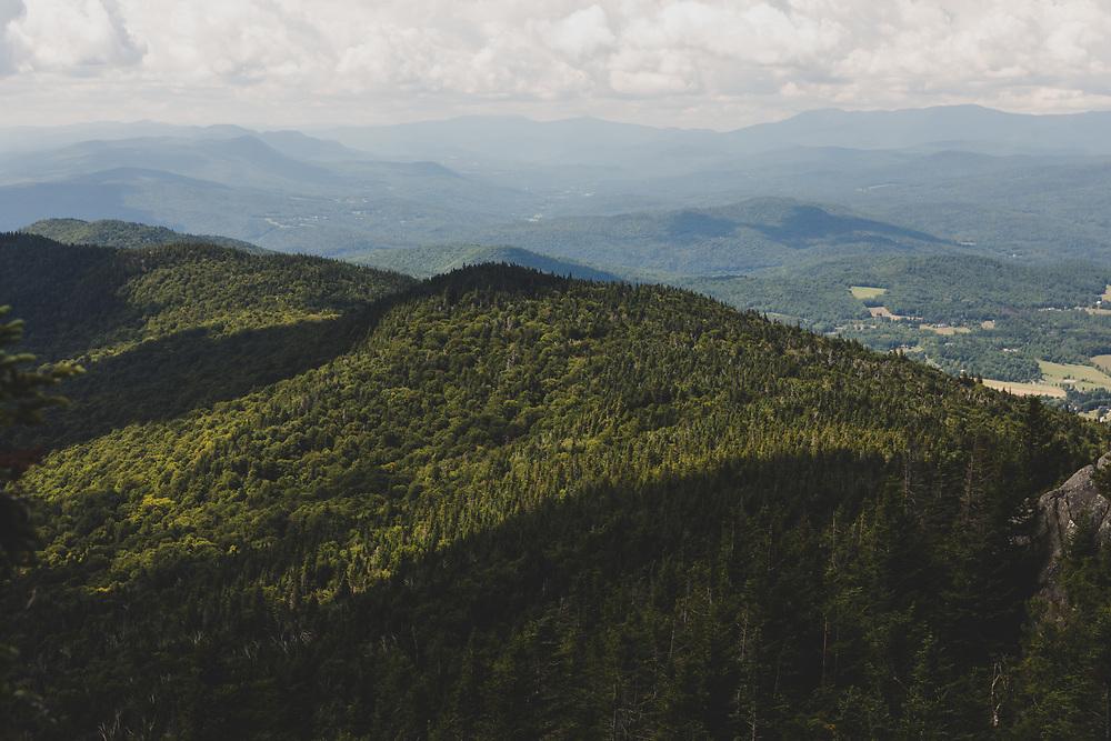 Afternoon sunlight illuminating the alpine hills of Vermont.