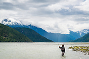 With the Dean Channel and Coast Mountains as a backdrop, David Page works a tidewater run on BC's Dean River.
