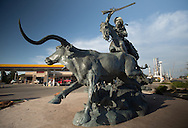 Trail Boss,a  sculpture by Vic Payne in Artesia New Mexico near the Navajo Refinery on the city's main street. Artesia is in the Permian Basin's oil patch