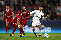 Real Madrid's Marco Asensio (right) and Sevilla's Nicolas Pareja battle for the ball