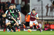 Mauro Zarate of West Ham United runs past Geoff Cameron of Stoke City. Barclays Premier league match, West Ham Utd v Stoke city at the Boleyn Ground, Upton Park  in London on Saturday 12th December 2015.<br /> pic by John Patrick Fletcher, Andrew Orchard sports photography.