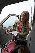 Jessica Koning, the Big Sur Condor Field Supervisor for the Ventana Wildlife Society, tracks california condors in her truck using radio telemetry.