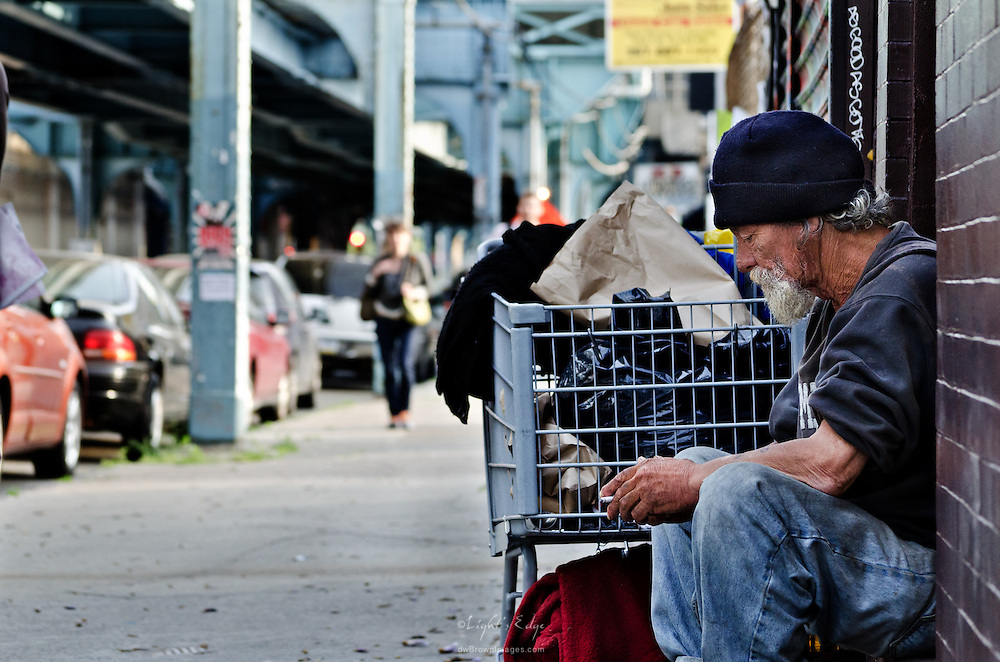 A homeless man sits on a stoop in the Fishtown section of Philadelphia.