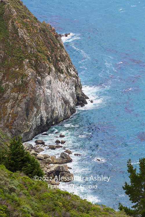 Cliffside view of the rugged Pacific coastline at Big Sur, California.