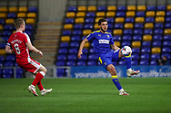 AFC Wimbledon defender Nesta Guinness-Walker (18) about to volley ball during the EFL Sky Bet League 1 match between AFC Wimbledon and Gillingham at Plough Lane, London, United Kingdom on 23 February 2021.