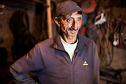 Portrait of the local blacksmith at the Roma area in Frumusani.