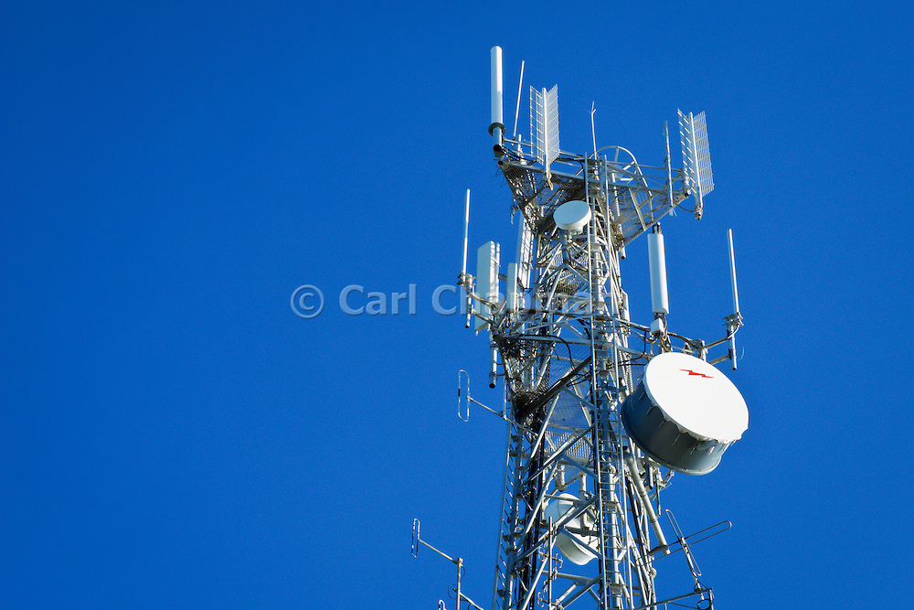 Cellular, microwave and telecom communications antenna array for the mobile telephone system on a cellsite tower. <br /> <br /> Editions:- Open Edition Print / Stock Image