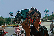 Vietnam, Hanoi: young boys on the streets selling books about the wars in  Vietnam..