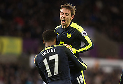 SWANSEA, WALES - Saturday, January 14, 2017: <br /> Arsenal's Alex Iwobi celebrates his second goal with Nacho Montreal against Swansea City during the FA Premier League match at the Liberty Stadium. (Pic by Gwenno Davies/Propaganda)