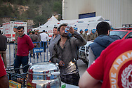 A miner drinks water during the rescue mission for colleagues at Soma, Western Turkey. More than 238 have been killed in the worst mining incident in Turkey for decades, whilst bodies continue to be pulled from the tunnels. An explosion happened after an electrical fault.