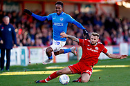 Portsmouth forward Jamal Lowe (10) is tackled by Accrington Stanley defender Nick Anderton (24) on loan from Blackpool,  during the EFL Sky Bet League 1 match between Accrington Stanley and Portsmouth at the Fraser Eagle Stadium, Accrington, England on 27 October 2018.