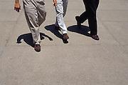 3 casual businessmen walking in city