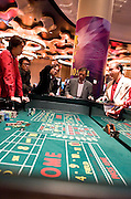 Gamblers play craps in City of dreams casino, in Macao, China, on December 17, 2009. Photo by Lucas Schifres/Pictobank