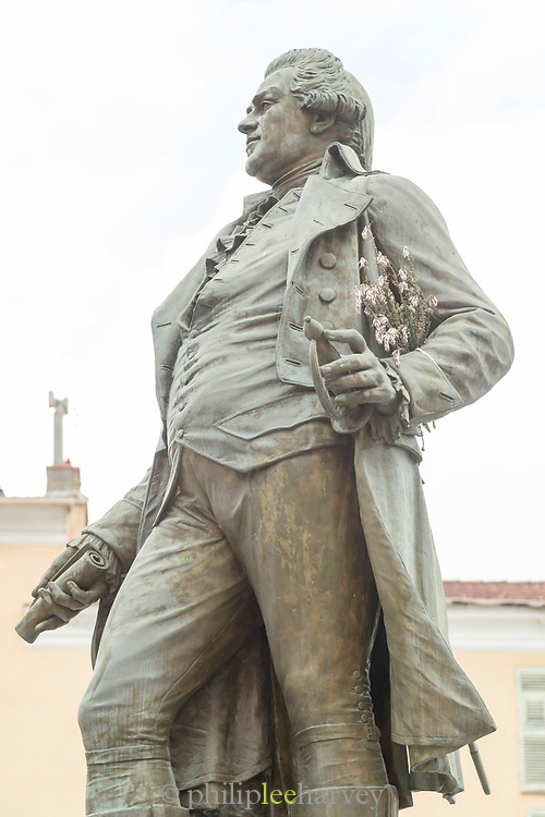 Low angle view of Pascal Paoli statue on city street, Corte, Corsica, France