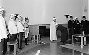 24th anniversary of Arab revolt under King Hussein & Lawrence 1940. The Emir receiving the Islamic religious officials, officers of the Arab Legion on the left
