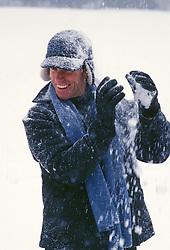Man Enjoying A Snowy Day