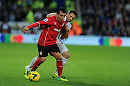 Cardiff city's Gary Medel (l) is challenged by Swansea's Angel Rangel.  Barclays Premier League match, Cardiff city v Swansea city at the Cardiff city stadium in Cardiff, South Wales on Sunday 3rd Nov 2013. pic by Andrew Orchard, Andrew Orchard sports photography,