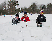 Brian Winslow and William Veenstra learn how to build an igloo with Nancy Davidson of Prescott Farm during Saturday's Winterfest activities.  (Karen Bobotas/for the Laconia Daily Sun)