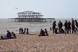 © Licensed to London News Pictures. 22/02.2014. Brighton and Hove, United Kingdom. sunshine and a cloudless sky brings visitors to the seafront in Brighton. thousands of people enjoying a wonderful day at the beach after weeks of storms, rain and floods. Photo credit : Hugo Michiels