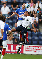 Fotball<br /> England<br /> Foto: Colorsport/Digitalsport<br /> NORWAY ONLY<br /> <br /> Football<br /> NPower Championship<br /> Preston North End vs Portsmouth at Deepdale in Preston.<br /> Portsmouth's Carl Dickinson battles with Preston North End's Joshua King<br /> 21/08/2010