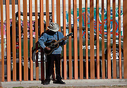 A guitar player practices in Benito Juarez Park as a Mexican Army patrol drives past January 17, 2009. The heavily armed military patrols the city to help stem the violence in the ongoing drug war which has already claimed more than 40 people since the start of the year. More than 1600 people were killed in Juarez in 2008, making Juarez the most violent city in Mexico.    (Photo by Richard Ellis)