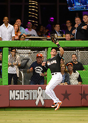 April 18, 2018 - Miami, FL, U.S. - MIAMI, FL - APRIL 13: Miami Marlins left fielder Derek Dietrich (32) camps under a fly ball  during  a  Major League Baseball game between the Miami Marlins and the Pittsburgh Pirates on April 13, 2018  at Marlins Park in Miami, FL  (Photo by Juan Salas/Icon Sportswire) (Credit Image: © Juan Salas/Icon SMI via ZUMA Press)