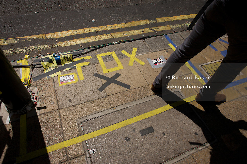 US Fox TV markings on pavement as tension mounts outside St Mary's Hospital, Paddington London, where media and royalists await news of Kate, Duchess of Cambridge's impending labour and birth. Some have been camping out for up to two weeks during a UK heatwave, having bagged the best locations where an heir to the British throne will eventually be shown to the world.