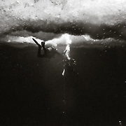 Divers in McMurdo Sound from the OB Tube.