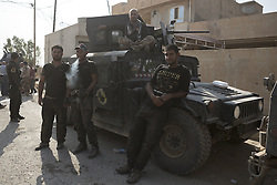 October 23, 2016 - Bartella, Nineveh, Iraq - Iraqi Army  Counter Terrorism soldiers relax in the Iraqi Town of Bartella...Bartella, a mainly Christian town with a population of around 30,000 people before being taken by the Islamic State in August 2014, was captured two days ago by the Iraqi Army's Counter Terrorism force as part of the ongoing offensive to retake Mosul. Although ISIS militants were pushed back a large amount of improvised explosive devices are still being found in the town's buildings. (Credit Image: © Matt Cetti-Roberts/London News Pictures via ZUMA Wire)