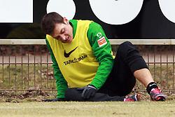 05.03.2010, Weserstadion, Bremen, GER,  1. FBL, Abschlusstrainingtraining Werder, im Bild Mesut Özil (Oezil GER Werder #11) mit neuen Schuhen in Pink / Flieder. Mit den Roten Schürsenkeln zur Aktion Lace Up, save lives. Er sitzt mit Schmerzen am Spielfeldrand und hält sich seinen linken Fuß / Knöchel. EXPA Pictures © 2010, PhotoCredit: EXPA/ nph/  Arend / for Slovenia SPORTIDA PHOTO AGENCY.