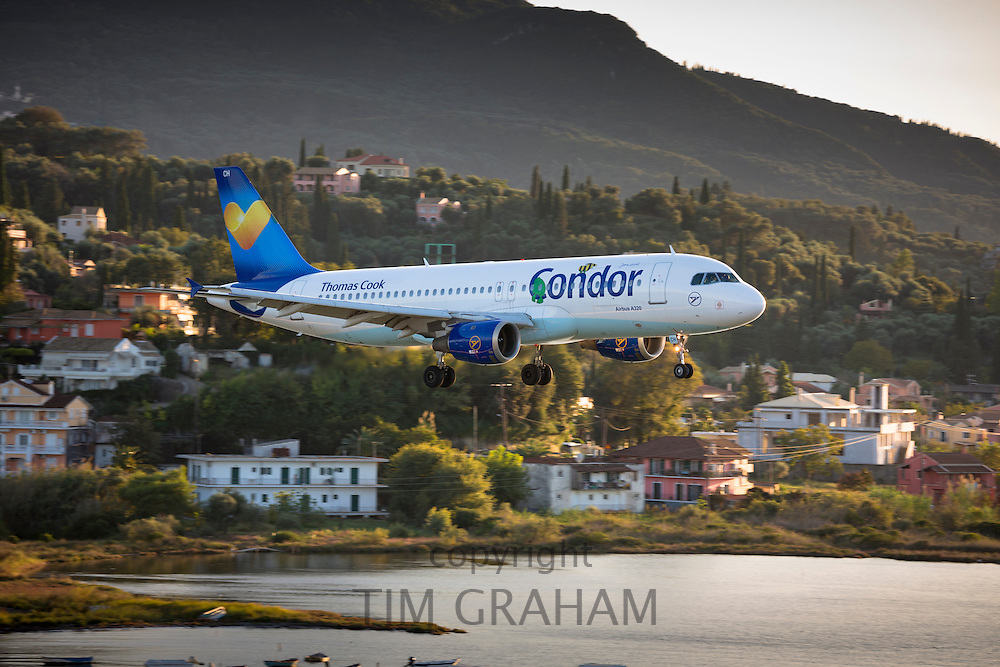 Thomas Cook Condor jet airplane tourist charter flight pilot flying into Kerkyra, Corfu Town, ready for landing, Ionian Islands, Greece