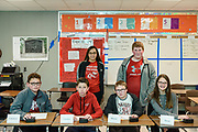 The Hancock County, KY High School Quiz Bowl Team at the beginning of round two, seated are, from left, Cameron Estes, 12, a seventh-grader, Camdem Lucas, 13, a seventh-grader, Mason Dixon, 13, a seventh-grader and Alexis Gay, 13, a seventh-grader. Standing behind them are substitute player Xavier Simpson, 14, an eighth-grader, and their coach, Bernice Kennedy.<br /> <br /> Teams compete in the preliminary rounds of the 2019 Kentucky Quiz Bowl Alliance Middle School State championship Saturday, April 27, 2019, at Noe Middle School in Louisville, Ky. (Photo by Brian Bohannon)