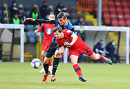 Wigan Athletic midfielder Chris Merrie (23) tumbles to the ground under challenge from a Rochdale player during the EFL Sky Bet League 1 match between Rochdale and Wigan Athletic at the Crown Oil Arena, Rochdale, England on 16 January 2021.
