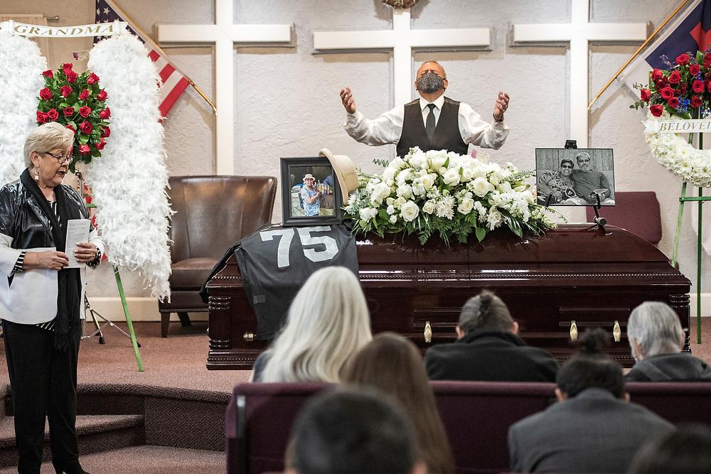 Sonny Mendez prays at his cousin Carmelita Martinez' funeral at Pastor El Buen church in San Jose, Calif. on Feb. 3, 2021.