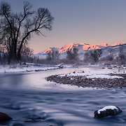 The Middle Provo River and Mt. Timpanogos during a white winter at sunrise.