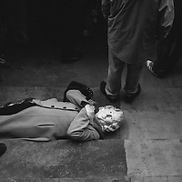Liverpool, UK, 17th April, 2013. A woman dressed as Margaret Thatcher plays dead on the steps of St Georges Hall.